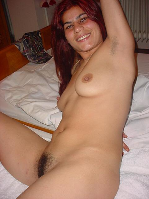 Irina posing on bed
